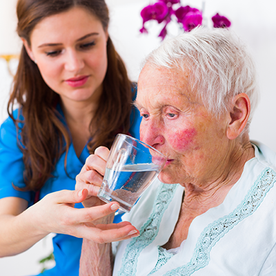 care worker assisting client with medication