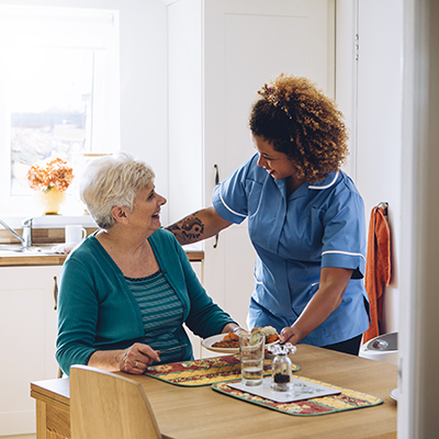 carer helping client with food