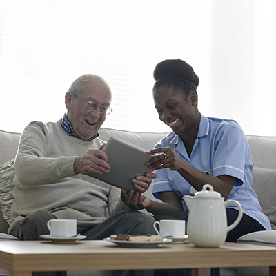 care worker smiling with elder man